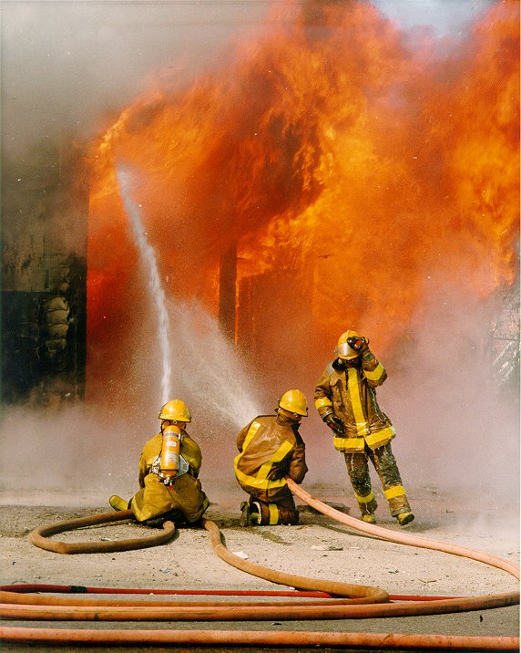 Firefighters battle a fire
